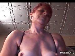 Mature hottie in lingerie pleasing cunt with vibrator