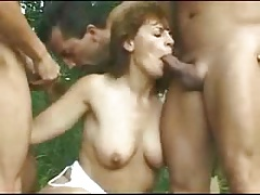 Hairy mature creampied in a outdoor gangbang