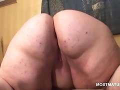 Slutty bbw mature sucks and tit fucks large dildo
