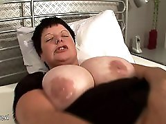 Big titted mama squirts heavily when she cums