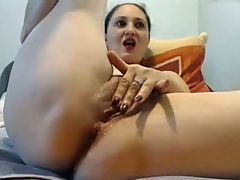 She fingers herself and uses toy till she cums