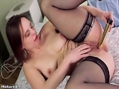 See how this big boobed mom shoves her golden toy deep