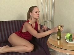 Blond cutie plays with bottle