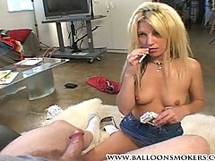 Hot blonde giving a blowjob while smoking and drinking a bee