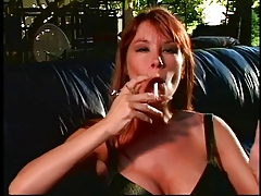Cute Brunette Smoking A Cigarette Gets A Nice Titty Fuck And Cum Load