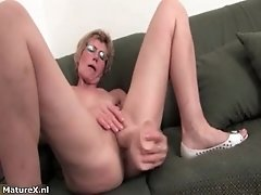 Horny Old Woman Plasuring Her Wet Pussy With A Big Real