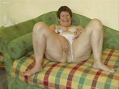 Horny granny masturbating her big pussy