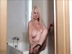 Granny strips and masturbates