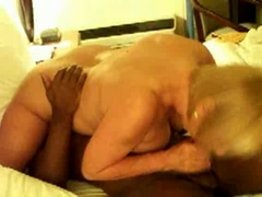 Mature blonde wife having fun with black dude
