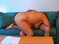 Fat redhead mature pleasured by young boy