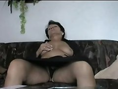 Mature Strips and Fingers Herself to Orgasm