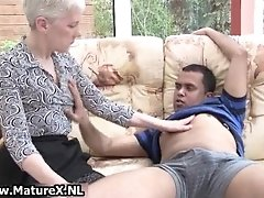 Old experienced woman is enjoying teasing sex games wit
