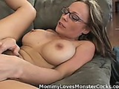 Mature horny momma is fucking a big black cock on the sofa