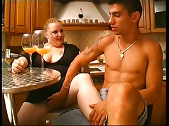 Sexy blonde big mama has an appetite for cock in this kitchen