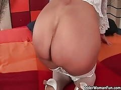 Grandma Merilyn wears stockings and pushes a dildo up her ass