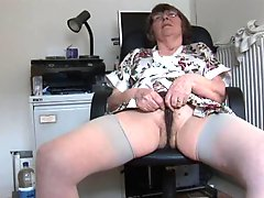 Hairy granny in stockings strips and spreads
