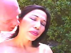 Horny Asian Mature takes two cocks in the sun